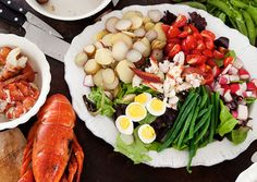 Summer House Lobster Salad  Guests can chip in to make quick work of this casually elegant salad; steaming the vegetables and lobsters in stages in the same pot keeps cleanup to a minimum.