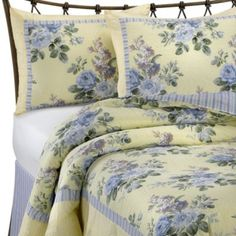 This Laura Ashley quilt set sports a yellow and blue floral print ... : laura ashley caroline quilt - Adamdwight.com