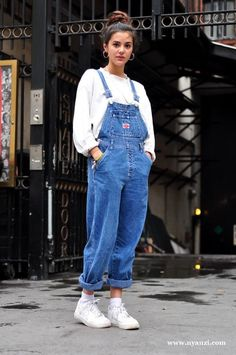 Glastonbury Festival Fashion Inspiration. hippie, bohemian, boho. Blue denim jean dungarees, 90s, hoop earings, retro trainers, bun hair style