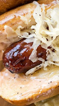 """The """"Reuben"""" Roll with Smoked Sausage, Sauerkraut, Homemade Russian Dressing and Melty Swiss on a Pretzel Roll"""