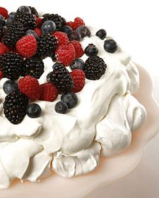 I am making one of my famiy's favorite desserts tonight. This recipe for pavlova, a light meringue dessert, comes courtesy of actor Geoffrey Rush. Meringue Desserts, Köstliche Desserts, Delicious Desserts, Dessert Recipes, Yummy Food, Meringue Food, Meringue Pavlova, Plated Desserts, Martha Stewart Recipes