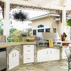 Summer villa - traditional kitchen in white with windows to the front lawn
