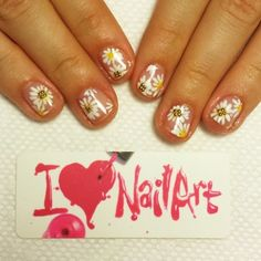 Petite daisies and tiny gold stones in the center! Love it. #nails