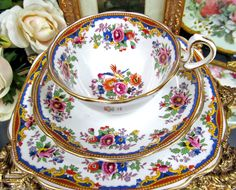 Royal albert tea cup and saucer trio flowers and birds pattern 1920's