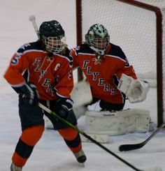 """""""A Ninja and Her Defense Woman"""" Photo taken by Angela Drake Photo was taken on 03/09/14. Photo is of Youth Hockey for Sioux Falls Lady Flyers in the youth division of Girls Varsity Hockey. Players in the photo are #5 Jessica Sandal #4 Brittany Corcoran"""