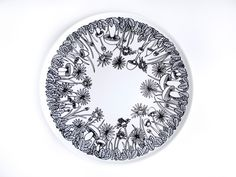 DIY redesign. Draw on your old white plates with a porcelain pen and create personal and beautiful art for your table.