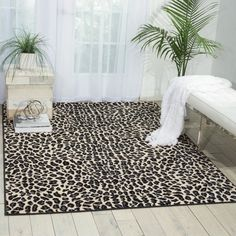 Tie together your living room seating group or accent the foyer with this stylish rug, showcasing a chic leopard print motif.