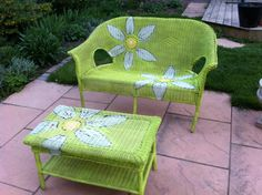 revamping an old wicker love seat and table with a cheerful colour and some daisies.