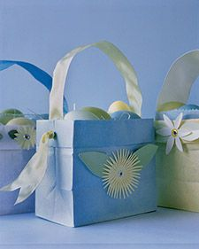 These pastel paper bags decorated with construction paper are a whimsical alternative to the traditional woven baskets.