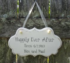 "Anniversary / Wedding Sign, Hand Painted Wooden White Shabby Chic Decoration Anniversary / Wedding Sign, ""Happily Ever After Since..."", via Etsy."