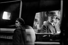 Bruce Davidson, Man and woman reflected in car window, London, 1960