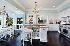 White kitchen. wall colors, blue walls, beach houses, design kitchen, open kitchens, white cabinets, kitchen designs, dream kitchens, white kitchens
