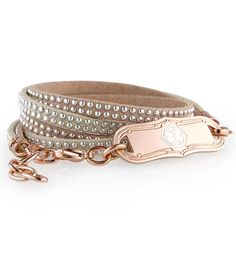 "Parker is a dual-strand, wrap-style, tan and beige suede medical ID bracelet with silver accents and a custom-engravable Rose Gold Tone La Petite Medical ID Tag. All of our wrap bracelets feature an affixed, custom-engravable medical ID tag and 1 ½"" of adjustable chain so you can wear them just the way you like! (From $49.95) 
