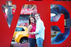 Engagement photo-session | cute romantic couple near famous LOVE sculpture in Manhattan, NYC | New York photos | Engagement Photography | Photo-session price : $350 when booked together with Wedding-day photos  | www.AnnasWeddings.com