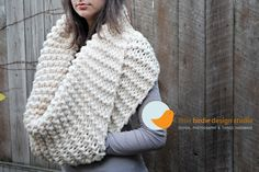 Chunky cowl with pocket. Knit wide scarf, fold over and join edges for 'pocket'. Smart!!