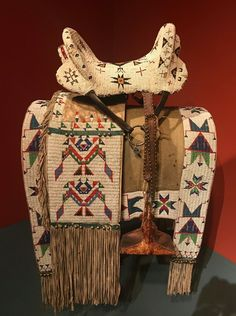 A down-right amazing Plains Indian Saddle and Ornately Beaded Blanket.