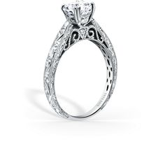 Kirk Kara  Stella collection  Design No. K161ENR.  This timeless design is a tapered classic solitaire engagement ring from the Stella collection. It features 0.02 ctw of diamonds. The signature handcrafted details include scroll hand engravings, milgrain edging, peek-a-boo diamonds and signature filigree. The center 1 carat round stone (shown) is a customized option.