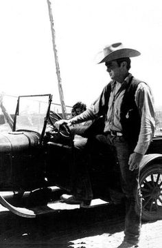 James Dean the Giant stepping into an old car