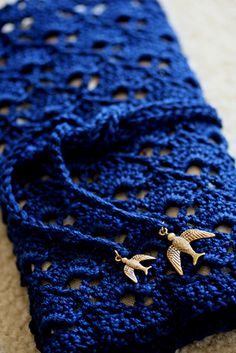 handmade crochet needle case with gold bird