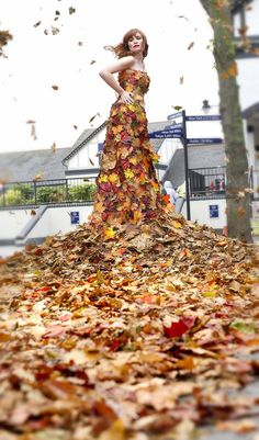 An amazing wedding dress from fall leaves. Its so well designed you can't tell where the fabric leaves on the  dress stops and the real fall leaves start. WOW.      blogs.liverpooldailypost.co.uk