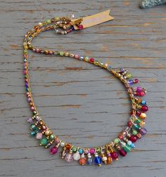 This necklace is full of bright sparkling colour!its crocheted with sparkly specialty crystals and gemstones and specialty beads, wire wrapped drops are added that sway a little. you cant help but notice it its fun, and colourful - approx 19 inche Jewelry Trends, Boho Jewelry, Jewelry Crafts, Beaded Jewelry, Jewelery, Jewelry Necklaces, Jewelry Design, Beaded Bracelets, Necklace Ideas