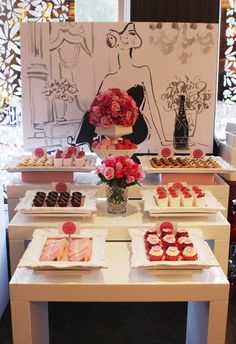 Dessert table black white red Notice the frames used to present the sweets