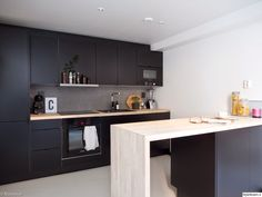Black kitchen with wooden counter tops