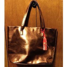 """NWOT bronze tote NWOT bronze faux leather tote with bright paisley lining and a magnetic snap closure. 18"""" x 12"""" x 5.5"""". Strap drop 8"""". Bags Totes"""