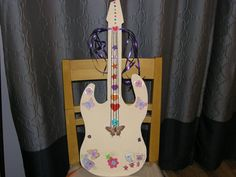 Recycled Craft: Rock star guitar for a rock star Halloween costume - Cut out of cardboard  and embellished with foam stickers.