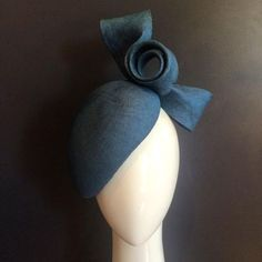 With steely resolve $425 stunning steel blue straw blocked into an easy wearing face higher with matching scrolled bow #milliner #millinery #bmwcaulfieldcup #springcarnival