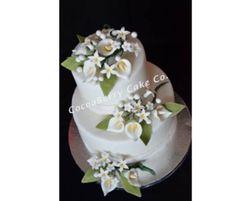 Lilies and Stephanotis Wedding Cake