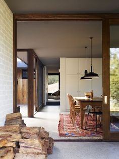 - like how the cabinets join the ceiling, how the doors join is interesting too, wall to ceiling join? - Merricks Beach House by Kennedy Nolan Architects.
