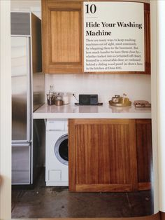 Don't like how contemporary it looks but still good idea. Sliding wood panel hides the washer and dryer via Remodelista Washer And Dryer Covers, Mini Washer And Dryer, Washer And Dryer Pedestal, Laundry Cabinets, Laundry Room, Hidden Laundry, House Yard, Interior Barn Doors, Home Deco