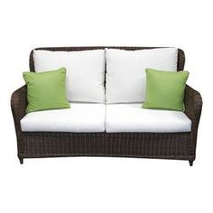 """Indoor/outdoor woven loveseat with Sunbrella cushions.   Product: LoveseatConstruction Material: Polyethelene, powder coated aluminum and sunbrellaColor: BrownDimensions: 36"""" H x 62"""" W x 34"""" DNote: Accent pillows not includedCleaning and Care: Frame can be cleaned with a mild detergent and water. Upholstery can be machine washed and air dried."""