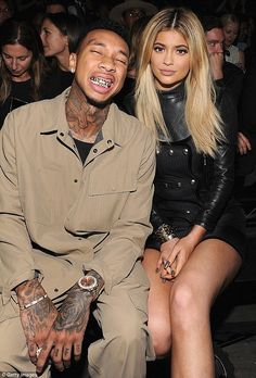 Cheese!: Tyga happily flashed his diamond and gold grillz at a fashion show with Kylie in September