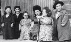 The Ovitzs (from left): Elizabeth, Perla, Rozika, Frieda, Franziska and Avram:- The Ovitz family were a family of Jewish actors/traveling musicians who survived imprisonment at the Auschwitz concentration camp during World War II. Most of them were dwarfs.They were the largest family of dwarfs ever recorded and were the largest family (twelve family members from a 15-month old baby to a 58 year-old woman) to enter Auschwitz and to survive intact.