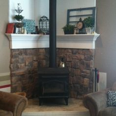 decorating corner wood stove | have a fireplace just like this... hard to decorate a corner mantle