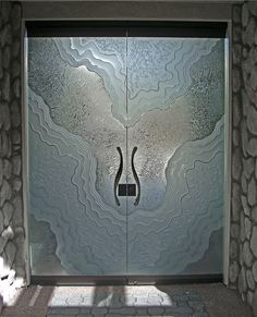 Metamorphosis I - all glass doors frameless entry doors etched carved by Sans Soucie Art Glass.