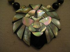 Un Worn Vintage Lee Sands blue lavender white mother of pearl with black onyx mother mosaic lion head black resin back cameo style center with a row of onyx, tiger eye and gold tone metal beaded necklace gold tone lobster claw clasp.  Lion head length 2 & 1/2 inch, width 2 & 1/2 inch. Necklace Length 41 & 1/8 inches.  See matching pierced earrings and bracelet. Also see similar set with tiger eye, onyx and gold tone beaded stretch bracelet.  I offer multiple item o...
