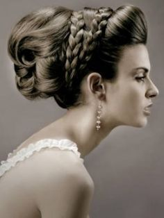 Big wedding up-do Hairstyle with heavy volume and Braided center accent pieces.