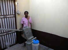 Immediately following the inauguration ceremony, this woman collect her first bucket of water from a new well. #haiti