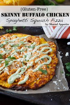 Dear Lord, YUM.. this I've gotta try It looks delicious.  skinny buffalo chicken pizza with spaghetti squash pizza crust