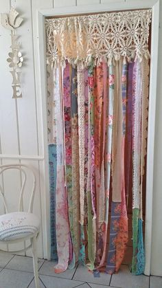 Shabby Chic Door/ Closet Curtain New and In Stock! Gorgeous One of a kind Boho Shabby Chic Curtain Vintage and Antique Linens were used..curtain can be displayed in any space.Strips of vintage fabrics covered with gorgeous florals. Can be tied to the side or walked thru easily..There is a