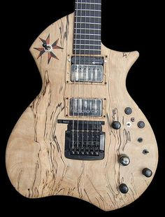 the Maltese Baritone guitar, a custom Baritone built by Crimson Guitars in the UK. She has ergonomic contours and a spalted beech top, MIDI, Sustainer and scatterwound pickups..     Wanna Play guitar like a Pro?  Come check this online site out!