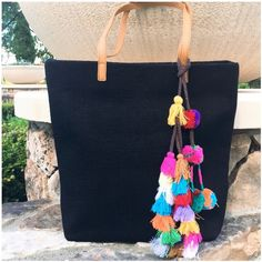 """Natural Fiber Lined Woven Tote Bag  w/ Tassels Natural Fiber Lined Woven Tote Bag  w/ Tassels 💕 --- Perfect for toting your books or your beach blanket --- Generously sized 15""""x 16""""x5"""" --- Lined interior has two open pockets and one zippered compartment --- Vegan leather handle has a 10.5"""" drop and fits comfortably over shoulder --- dust bag included --- thank you for visiting my boutique, please feel free to ask any questions 💕💕😌 Boutique Bags Totes"""
