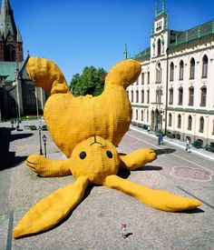 Giant toy bunny-covered with yellow shingles, displayed in Orebro, Sweden