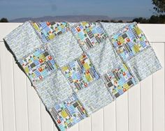 """This easy baby quilt is perfect as a last minute<a href=""""http://www.allfreeholidaycrafts.com/Baby-Shower-Crafts"""" target=""""_blank"""">DIY baby showergift</a>. The parents will love the design and baby will stay cozy warm while napping. The 30 Minute Baby Quilt can be made entirely out of your scrap fabric that you have lying around. This scrap buster project is super quick and ..."""