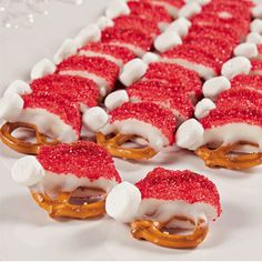 Santa Hat Pretzels- dip 1/2 of twisted pretzel in white choc and dip in red sanding sugar. Use mini marshmallow for ball.