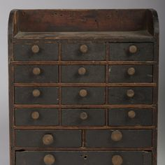 """The arched sides joining a case with four rows of three drawers over and arrangement of three drawers. 23 1/4""""h x 20 3/4""""w x 9 1/2""""d"""