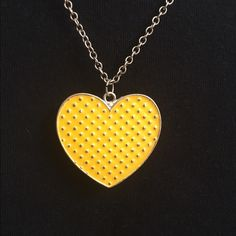 Yellow Heart Necklace Chain is a bit discolored barley noticeable still very pretty with plenty of use in it... Heart is a bright yellow very nice!!  . Make an offer! Jewelry Necklaces